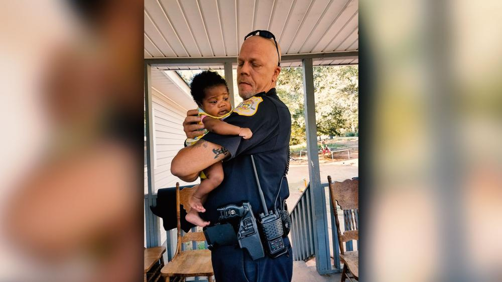 Police Officer Who Saves Choking Baby Accepts Offer to Be