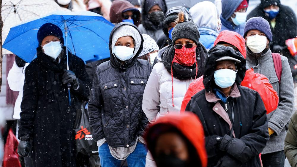 People wait in line at a 24-hour, walk-up COVID-19 vaccination clinic hosted by the Black Doctors COVID-19 Consortium at Temple University's Liacouras Center in Philadelphia. (AP Photo/Matt Rourke, File)