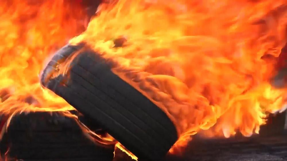 Setting tires on fire, Photo, CBN News