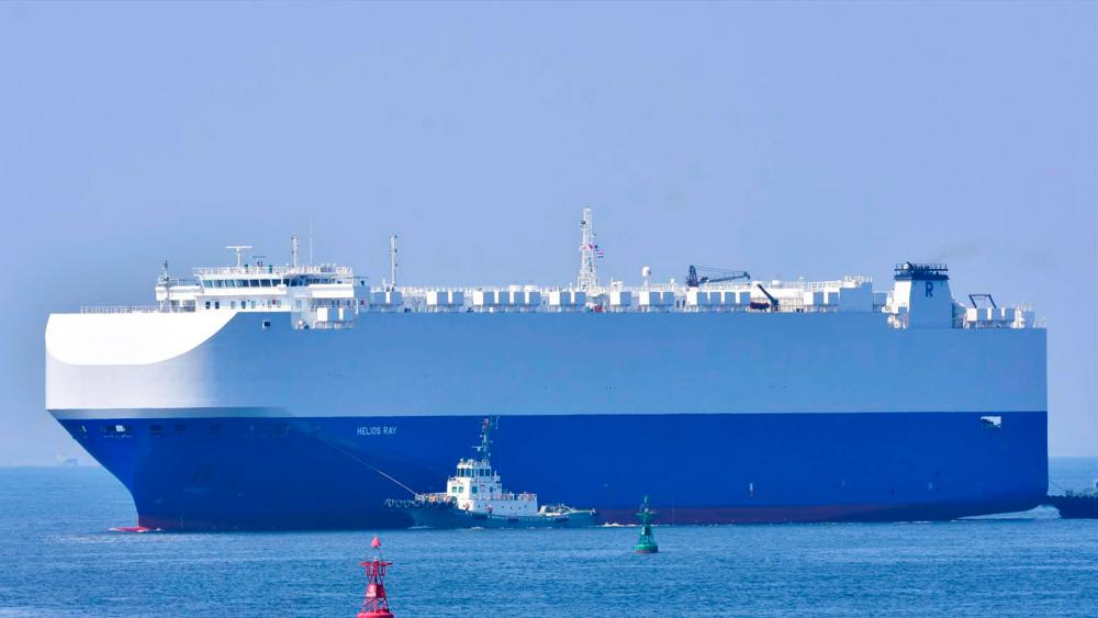 In this Aug. 14, 2020, photo, the vehicle cargo ship Helios Ray is seen at the Port of Chiba in Chiba, Japan. (Katsumi Yamamoto via AP)