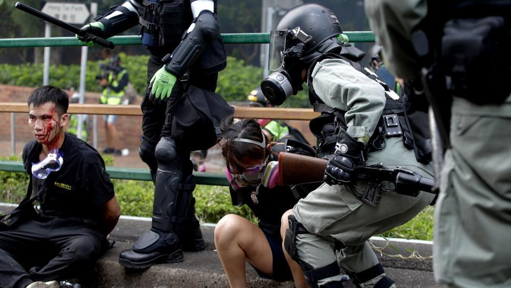 Riot police detain protesters near Hong Kong Polytechnic University in Hong Kong, Monday, Nov. 18, 2019. (AP Photo/Achmad Ibrahim)