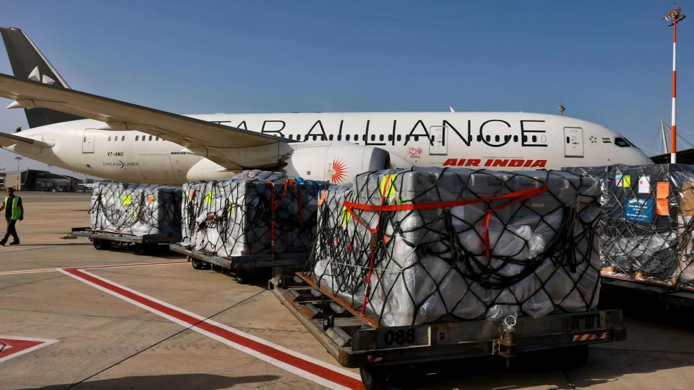 Workers load medical aid onto an Air India plane to be flown to India, at Ben Gurion Airport near Tel Aviv, Israel, Tuesday, May 4, 2021. (Menahem Kahana/Pool Photo via AP)