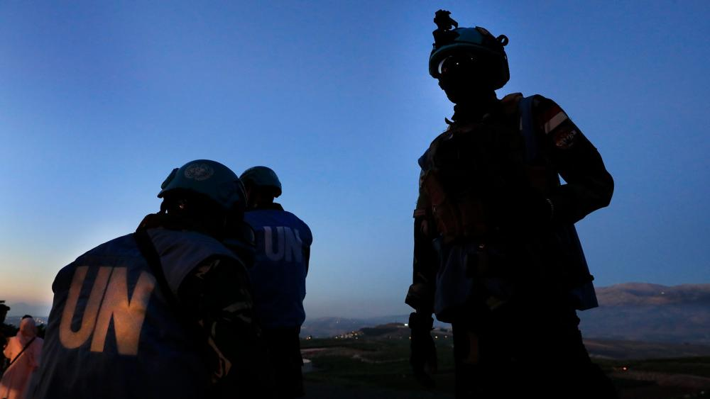 Indonesian U.N peacekeepers stand guard at the Lebanese side of the Lebanese-Israeli border in the southern village of Kfar Kila, Lebanon, Saturday, May 15, 2021. Israel warned Lebanese authorities not to allow protesters to breach the border. (AP Photo/H