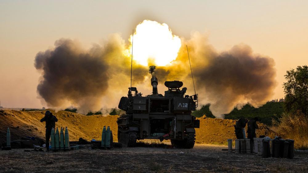 In this May 19, 2021, file photo, an Israeli artillery unit fires shells towards targets in Gaza Strip, at the Israeli Gaza border. (AP Photo/Tsafrir Abayov, File)