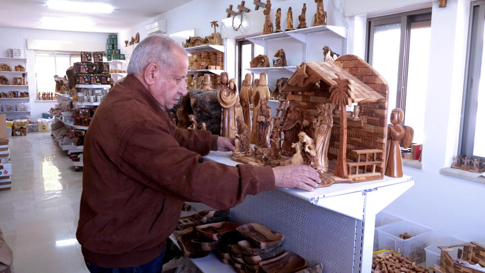 Jamil Hosh works in his Star of Bethlehem Olive Wood Factory in Bethlehem. Photo Credit: CBN News