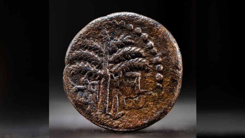 "Coin inscribed with the word ""Jerusalem"" and a picture of a date palm - Photo: Koby Harati, City of David Archive"