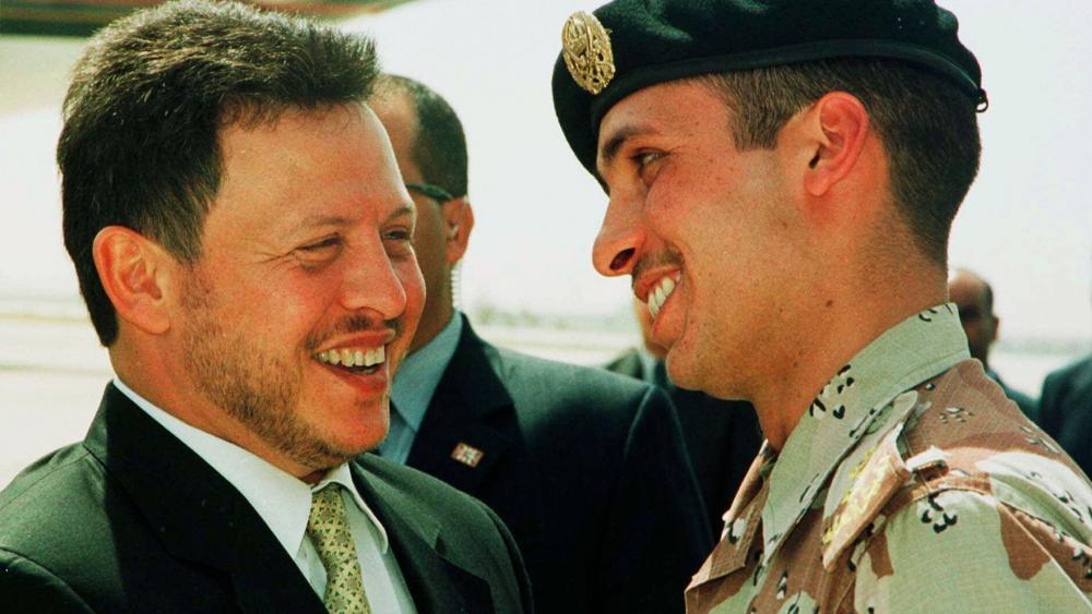 In this April 2, 2001, file photo, Jordan's King Abdullah II laughs with his half brother Prince Hamzah. (AP Photo/Yousef Allan, File)