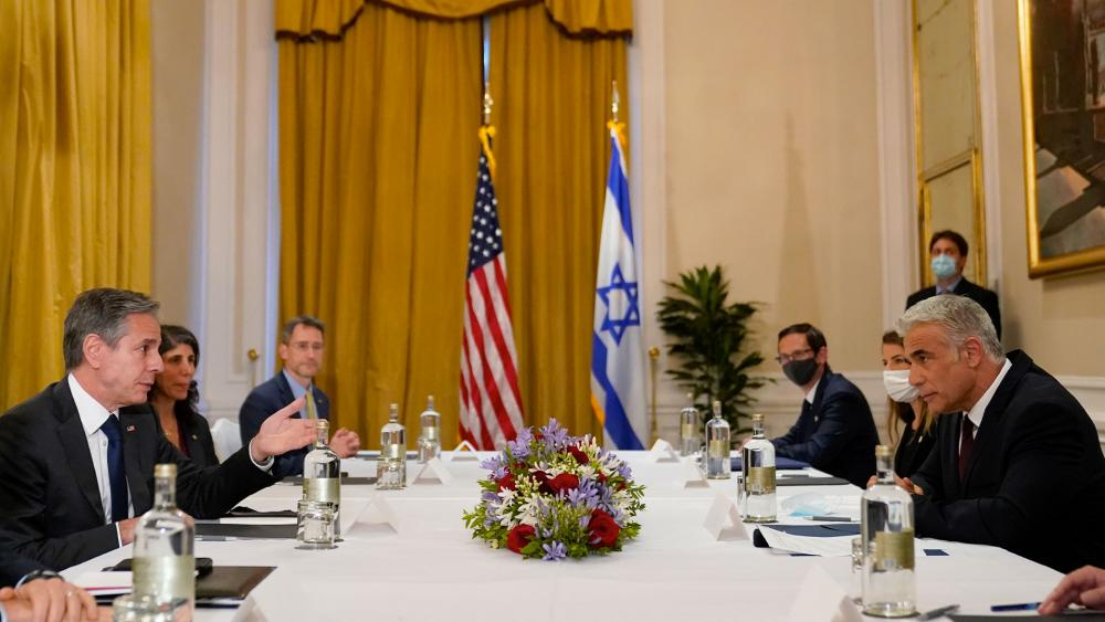 Secretary of State Antony Blinken, left, meets with Israeli Foreign Minister Yair Lapid in Rome, Sunday, June 27, 2021. Blinken is on a week long trip in Europe traveling to Germany, France and Italy. (AP Photo/Andrew Harnik, Pool)