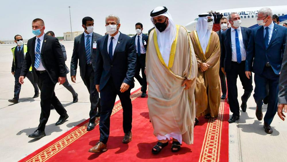 Israeli Foreign Minister Yair Lapid arrives in Abu Dhabi, United Arab Emirates, Tuesday, June 29, 2021. Photo Credit: Shlomi Amsalem/GPO via AP.