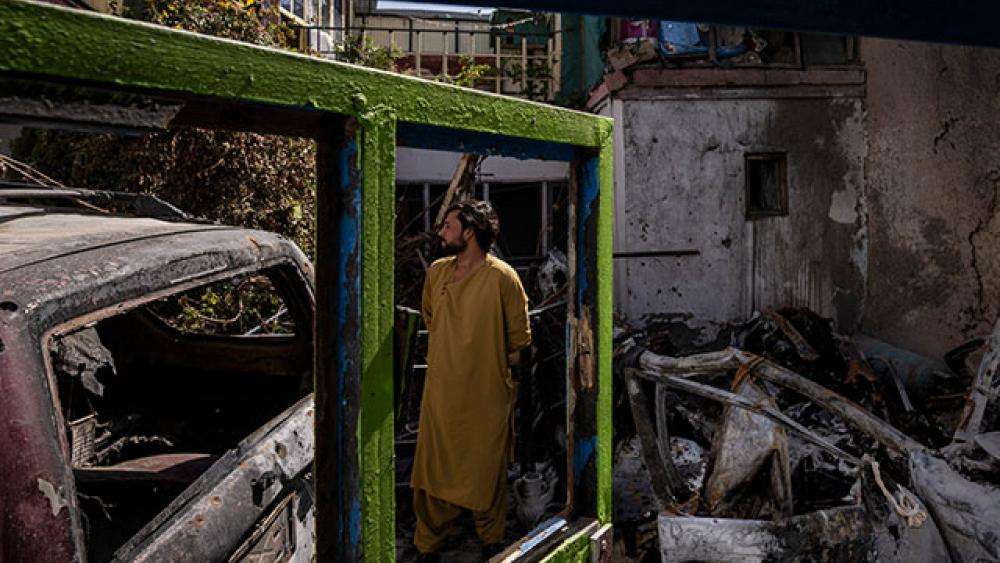 An Afghan inspects the damage of Ahmadi family house in Kabul, Afghanistan, Monday, Sept. 13, 2021. (AP Photo/Bernat Armangue)
