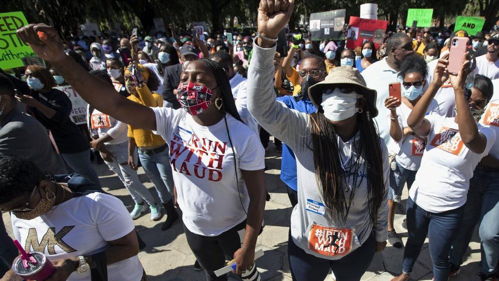 In this Friday, May 8, 2020, file photo, people hold a rally to protest the shooting of Ahmaud Arbery, an unarmed black man in Brunswick Ga (AP Photo/John Bazemore, File)