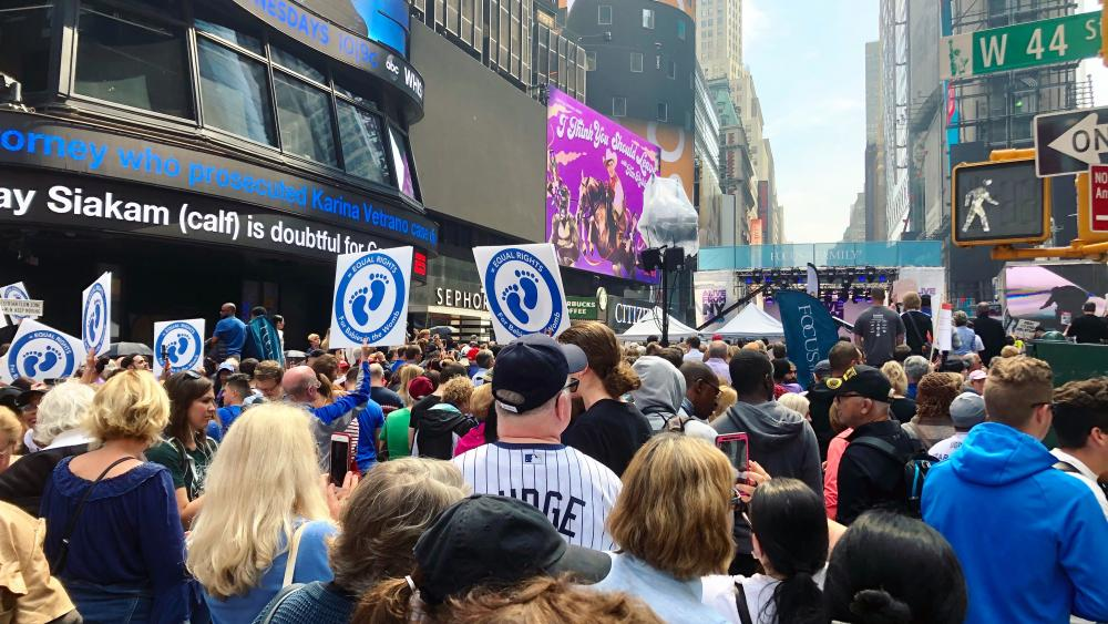 """Thousands packed New York City's Times Square on Saturday for the """"Alive from New York"""" event. (Image credit: Jenna Browder, CBN News)"""