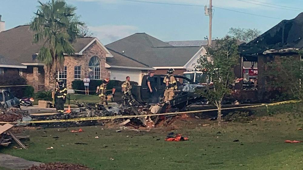 U.S. Navy training plane crashed in residential neighborhood near the Gulf Coast, Friday, Oct. 23, 2020 near Foley, Ala.(Greg Crippen via AP)