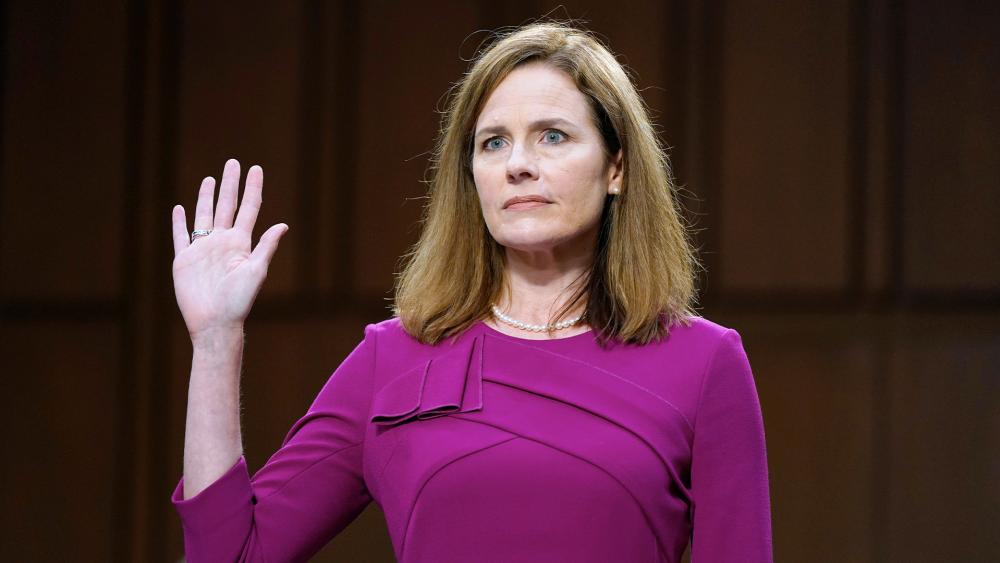 Supreme Court nominee Amy Coney Barrett is sworn in during a confirmation hearing before the Senate Judiciary Committee, Monday, Oct. 12, 2020, in Washington. (AP Photo/Patrick Semansky, Pool)