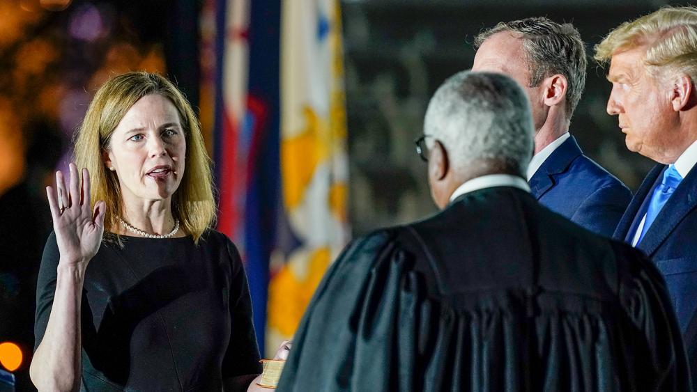 Supreme Court Justice Clarence Thomas administers the Constitutional Oath to Amy Coney Barrett on the South Lawn of the White House, Oct. 26, 2020, after Barrett was confirmed to be a Supreme Court justice by the Senate (AP Photo/Patrick Semansky)