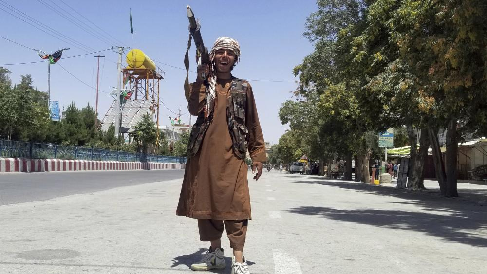 A Taliban fighter poses for a photo as he patrols inside the city of Ghazni, southwest of Kabul, Afghanistan, Thursday, Aug. 12, 2021
