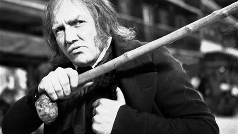 """This Jan. 15, 1970 photo shows British actor Albert Finney playing the title role in the film """"Scrooge"""". The film is a musical based on the Charles Dickens book """"A Christmas Carol"""". (AP Photo/Bob Dear, FILE)"""