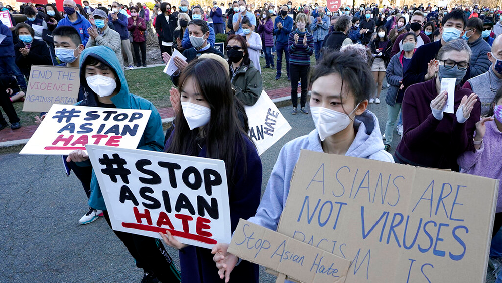 Asiaticos, protesta AP Photo-Steven Senne