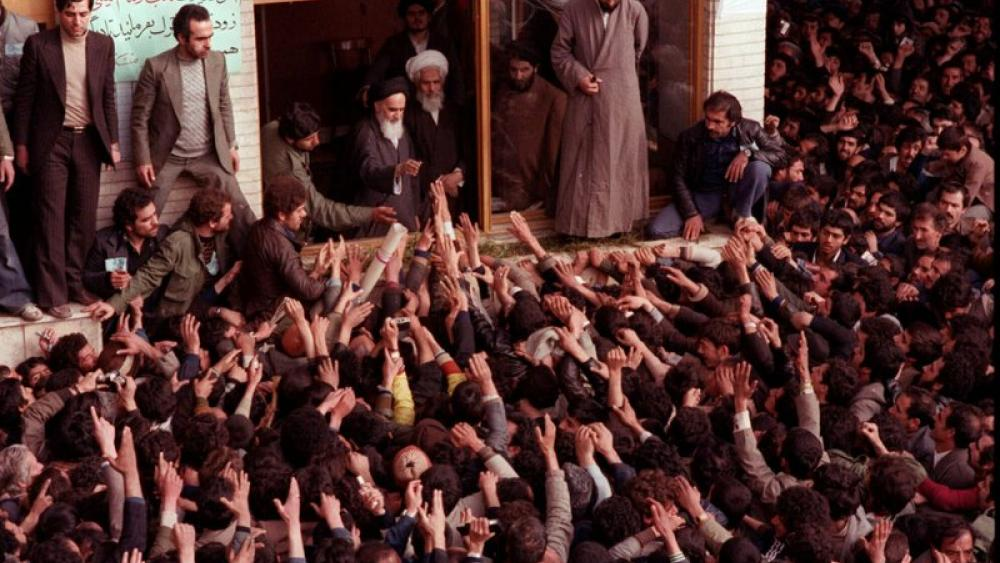 In this Feb. 2, 1979 file photo, Ayatollah Ruhollah Khomeini, center, is greeted by supporters in Tehran, Iran. (AP Photo, File)