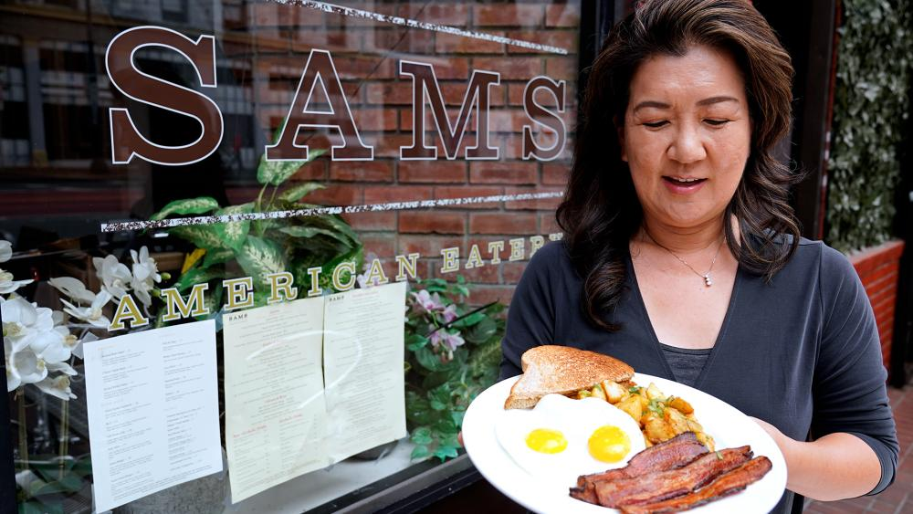 Jeannie Kim fears her breakfast-focused diner could be ruined within months by new rules that could make one of her top menu items — bacon — scarce in California. (AP Photo/Eric Risberg)