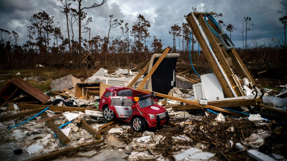 A toy fire engine sits in the rubble of a house destroyed by Hurricane Dorian in Gold Rock Creek, Grand Bahama, Bahamas, Thursday Sept. 12, 2019. (AP Photo/Ramon Espinosa)