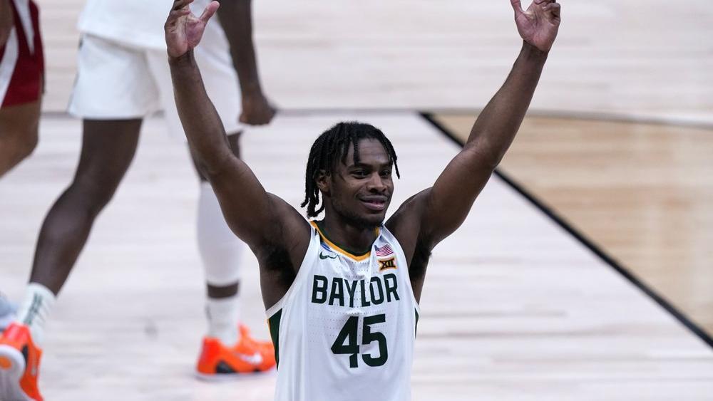 Baylor guard Davion Mitchell (45) celebrates beating Arkansas 81-72 (AP Photo/Michael Conroy)