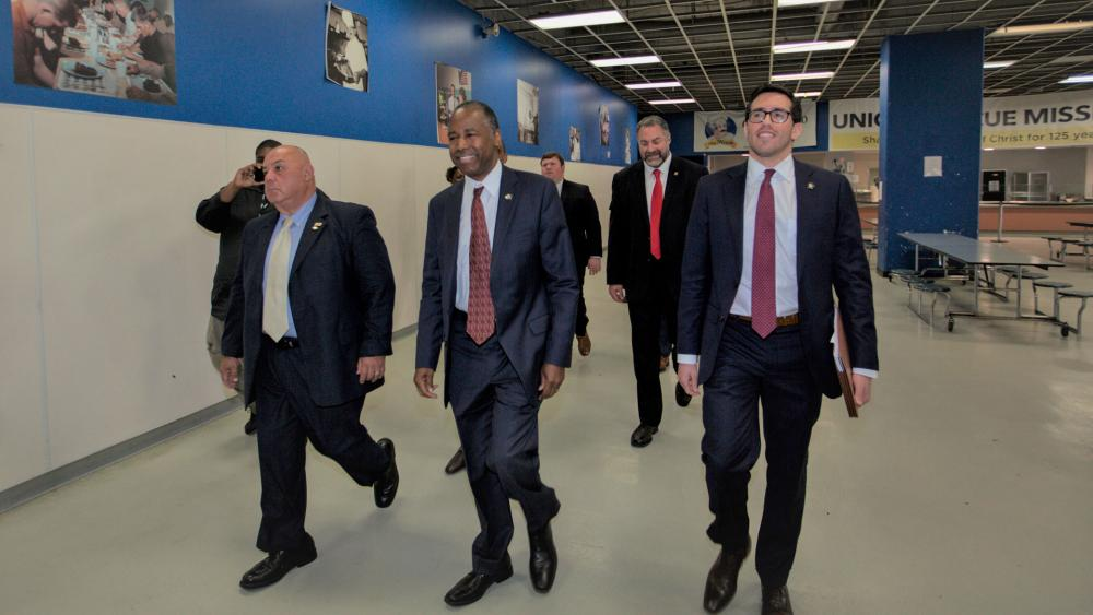 U.S. Department of Housing and Urban Development secretary Ben Carson, second from left, tours the Union Rescue Mission in Skid Row area of downtown Los Angeles Wednesday, Sept. 18, 2019. ((AP Photo/Damian Dovarganes)