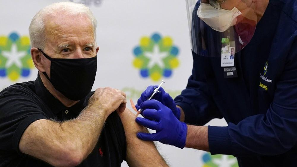 Image Source: Biden receives his second dose of the coronavirus vaccine (AP Photo/Susan Walsh)