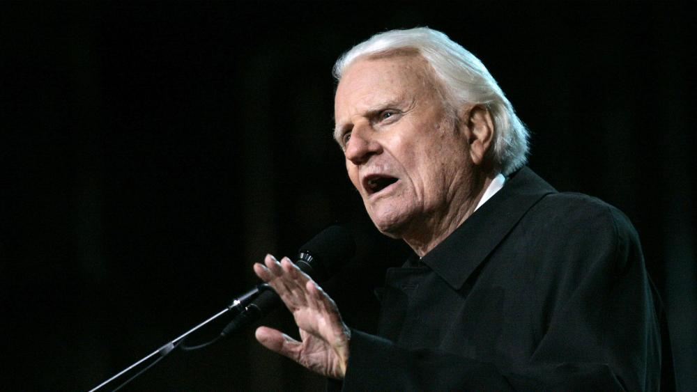 Who's in Charge of a World That's Suffering? Billy Graham's Reprinted Book Reminds Readers God's Still in Control thumbnail