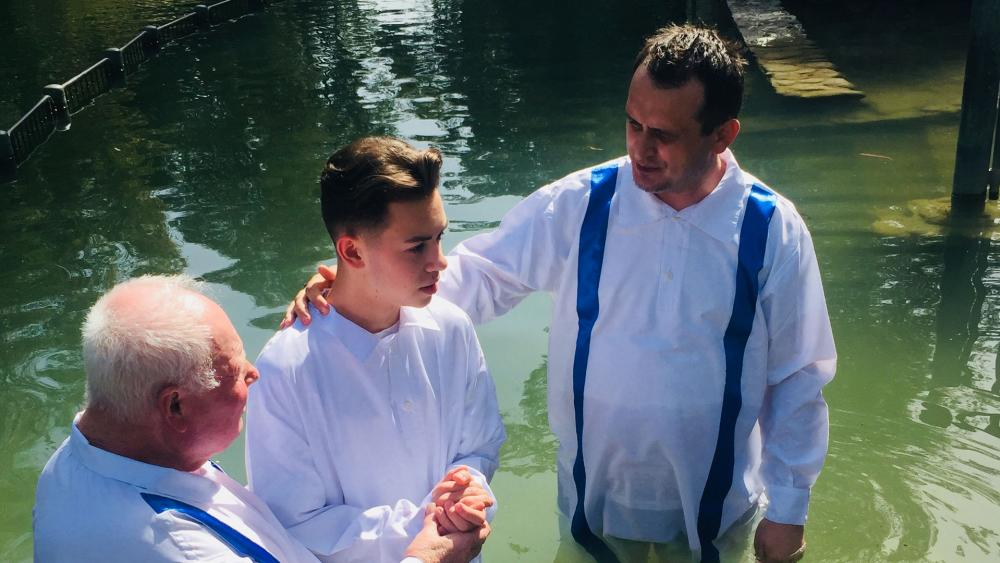Bishop Doru de Ilioi, right, prepares to baptize Eldad, a young man who asked to be baptized after watching Mario Lopez's baptism. On the left is Petre Ursu who assisted. Photo courtesy: Bishop Doru de Ilioi.