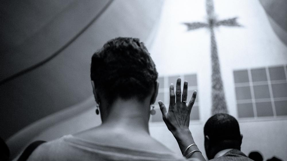 Black Christians in church (Adobe stock image)
