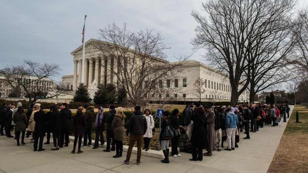Advocates for both sides of the Peace Cross case surround the US Supreme Court building on Wednesday, Feb. 27, 2019. (Photo by Patrick Robertson, CBN News.)