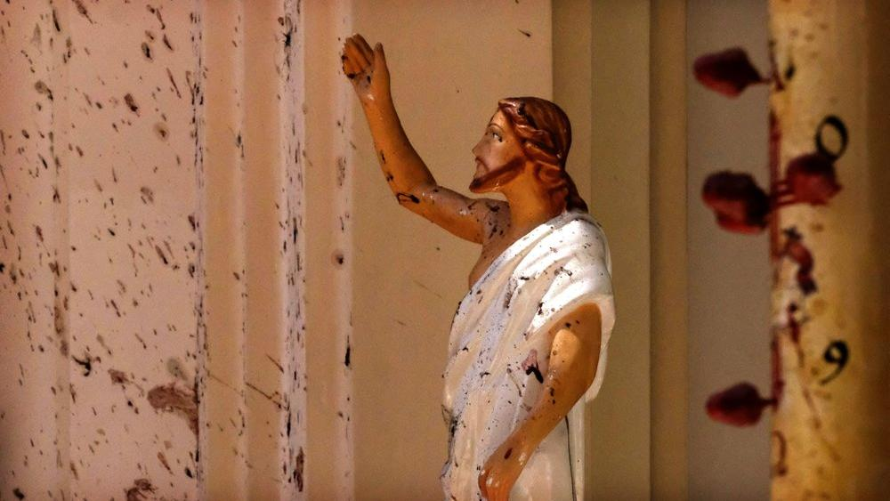 In this April 21, 2019, file photo, blood stains a Jesus Christ statue at the St. Sebastian's Church after a blast in Negombo, north of Colombo, Sri Lanka. (AP Photo)