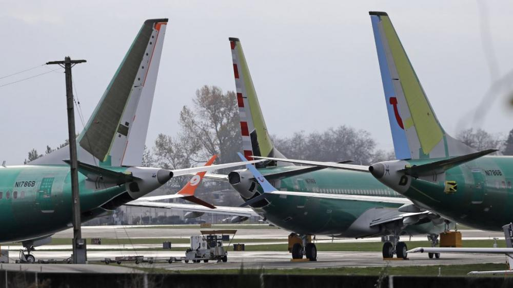 In this file photo Boeing 737 MAX 8 planes are parked near Boeing Co.'s 737 assembly facility in Renton, Wash. Investigators were rushing to the scene of a devastating plane crash in Ethiopia on Sunday, March 10, 2019. (AP Photo/Ted S. Warren File)