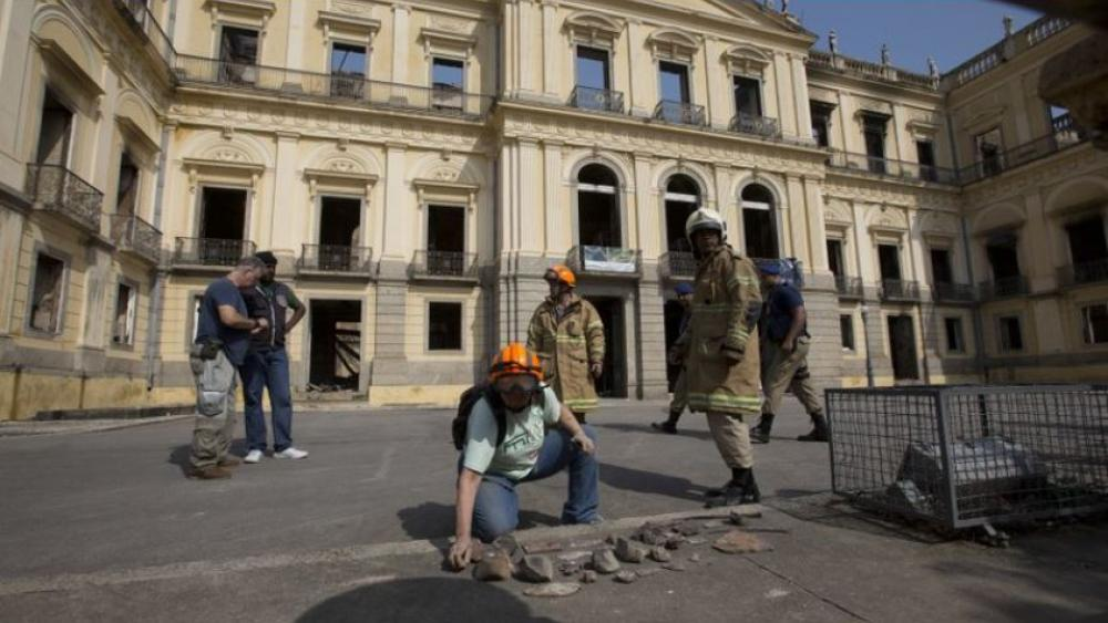 A National Museum worker organizes pieces from the museum after an overnight fire in Rio de Janerio, Brazil.