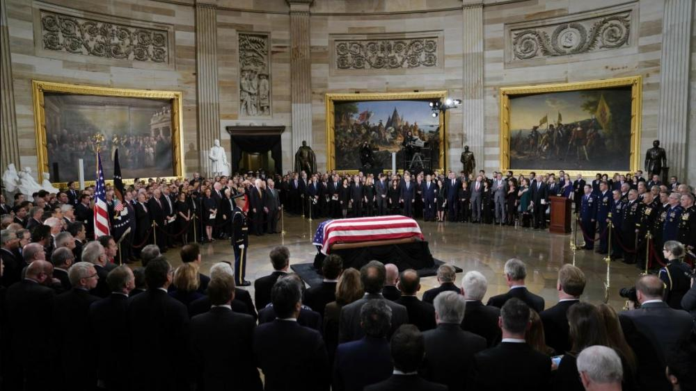 The flag-draped casket of former President George H.W. Bush lies in state in the Capitol Rotunda in Washington, Monday, Dec. 3, 2018. AP photo.