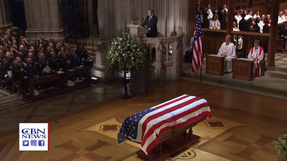 Former President George W. Bush delivers the eulogy for his father former President George H.W. Bush during the funeral service at Washington's National Cathedral Wednesday.
