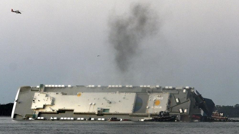 Smoke rises from a cargo ship that capsized in the St. Simons Island, Georgia sound Sunday, Sept. 8, 2019. (Bobby Haven/The Brunswick News via AP)