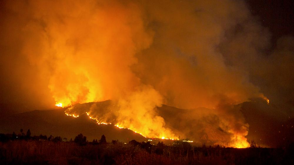 A wildfire burns in Yucaipa, California. (AP Photo/Ringo H.W. Chiu)