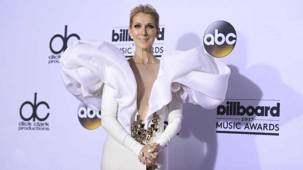"26624ec5 A Pennsylvania-based priest and exorcist has claimed singer Celine Dion's  new gender-neutral clothing line is ""demonic."" The ""My Heart Will Go On""  singer ..."