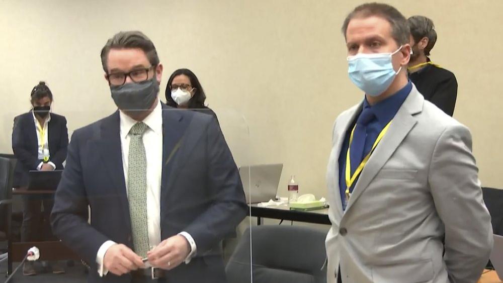 Defense attorney Eric Nelson, left, accompanied by defendant, former Minneapolis police officer Derek Chauvin (Court TV via AP, Pool)