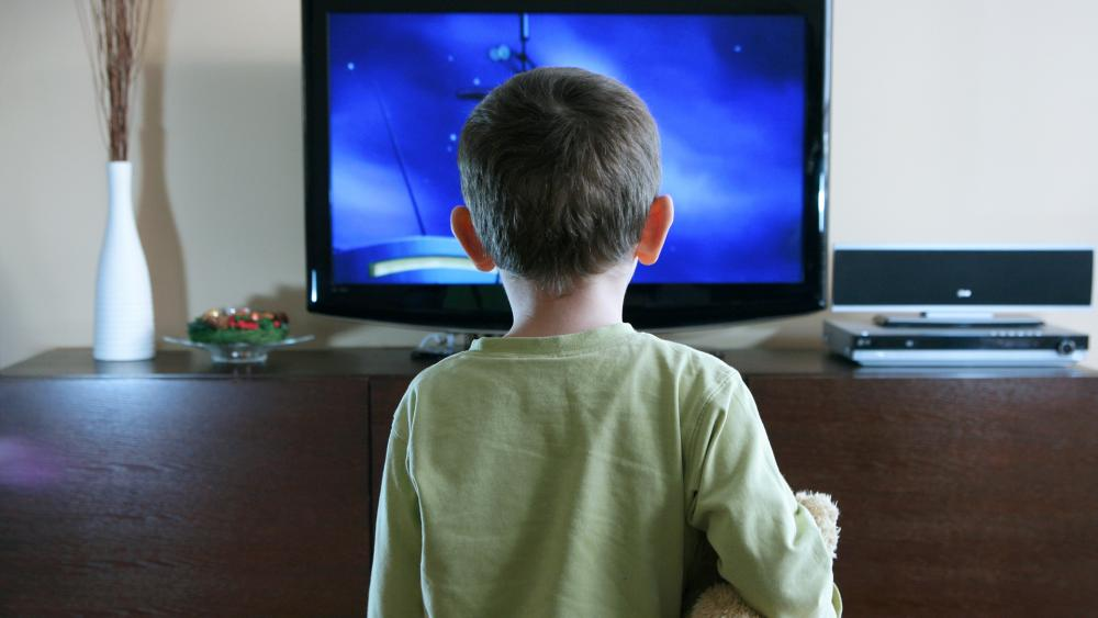 child watching television (Adobe Stock image)