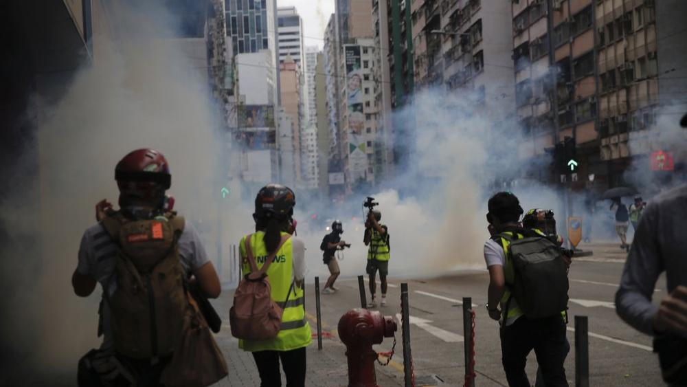 Hong Kong police fired volleys of tear gas in a popular shopping district as hundreds took to the streets on May 24, 2020 (AP Photo/Kin Cheung)