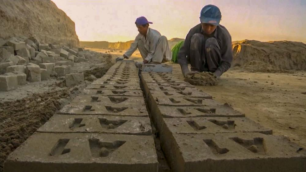Afghan children as young as 5 work to help support their families