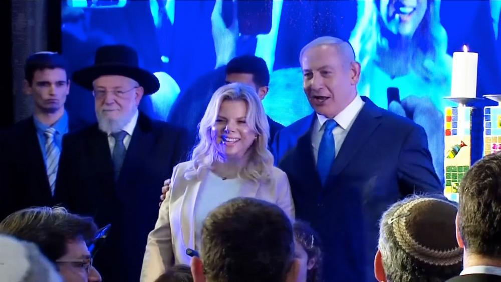 Israeli Prime Minister Benjamin Netanyahu and his wife, Sara, at Likud Party's Hanukkah Celebration, Photo, Screen Capture, GPO
