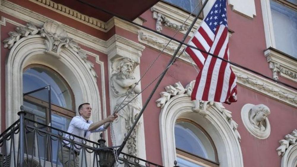 A consulate employee lifts up the U.S. flag at the U.S. consulate in St.Petersburg, Russia.