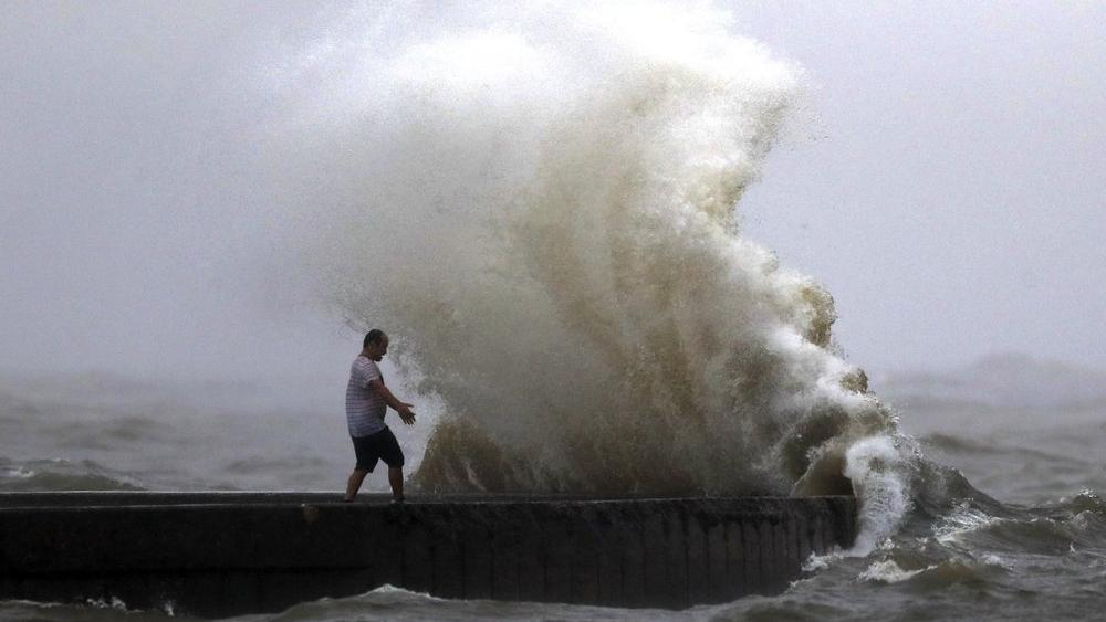 A wave crashes near Orleans Harbor in Lake Pontchartrain in New Orleans, Sunday, June 7, 2020, as Tropical Storm Cristobal approaches the Louisiana Coast. (AP Photo/Gerald Herbert)