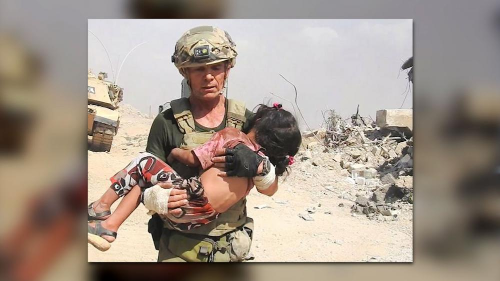 Dave Eubank with Free Burma Rangers Saves Iraqi Girl, Screen Capture