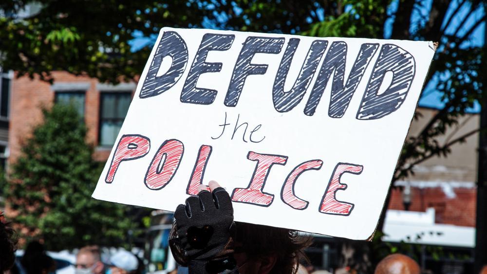 Defund the police protester (Adobe image)