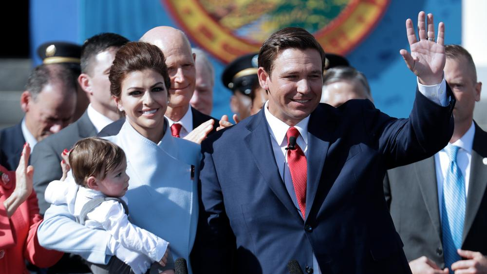 Florida Governor Ron DeSantis waves during an inauguration ceremony with his wife Casey and son Mason, Jan. 8, 2019, in Tallahassee, FL (AP Photo/Lynne Sladky)